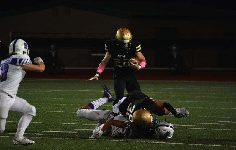 TIMES FILE PHOTO - Jesuit running back Ted Atkinson and fullback Logan Horton take on Beaverton on Friday night.