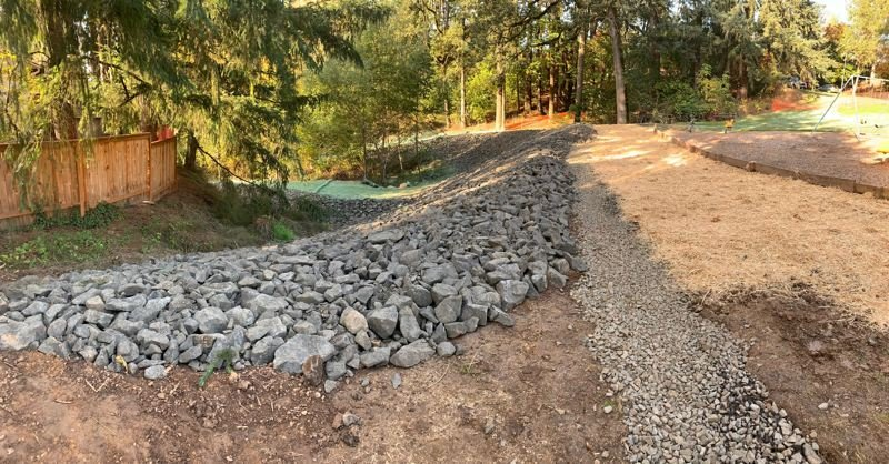 Rocks were laid down on a slope near Forest Glen Park in Forest Grove to mitigate erosion that was washing away part of the park area.