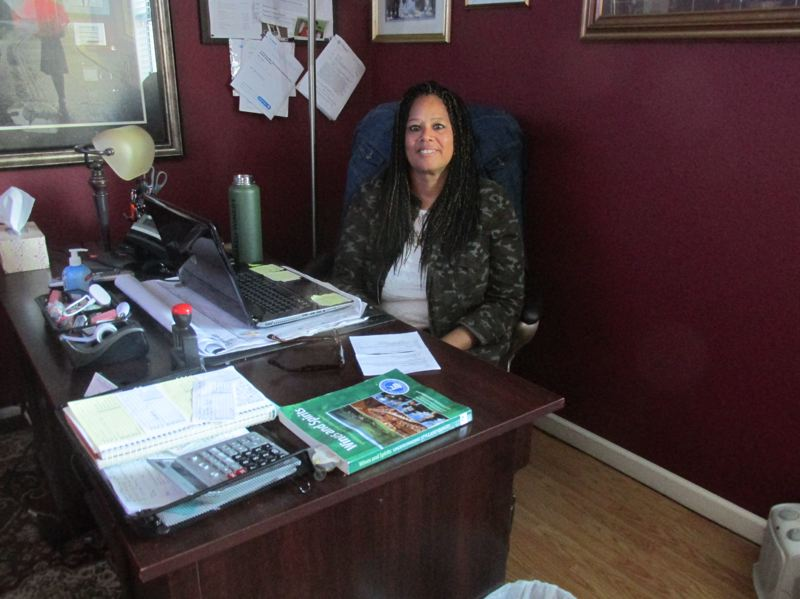 PMG PHOTO: SHANNON O. WELLS - After years working with residents at StoneyBrooke Residential Services, Donna Stoney is comfortable enough to embark on a new career while maintaining the business.