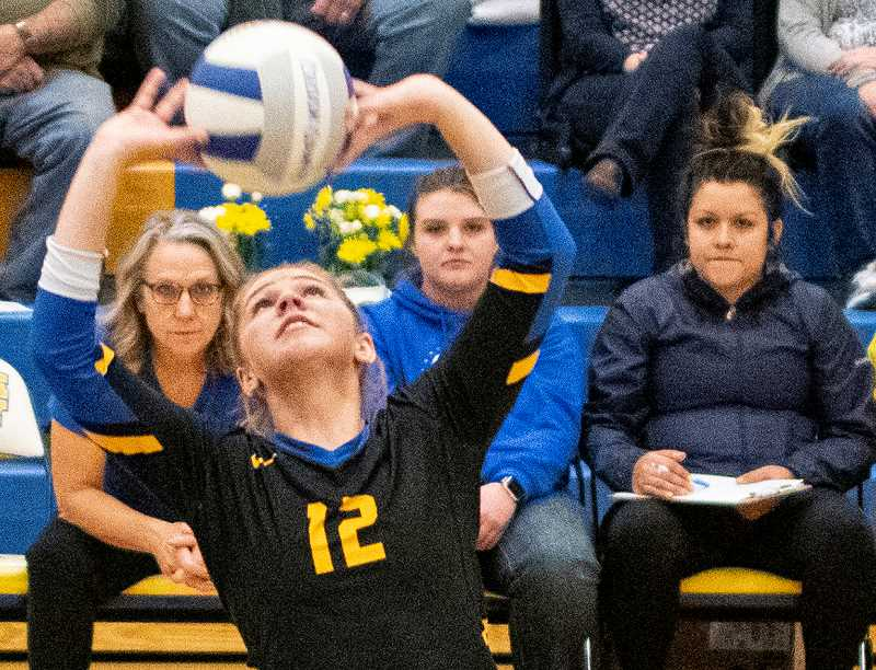LON AUSTIN/CENTRAL OREGONIAN - Crook County senior setter Anna Woodward passes a ball during the third set of the Cowgirls' victory over Redmond on Thursday. Woodward is one of five seniors that the Cowgirls recognized prior to the start of the match.