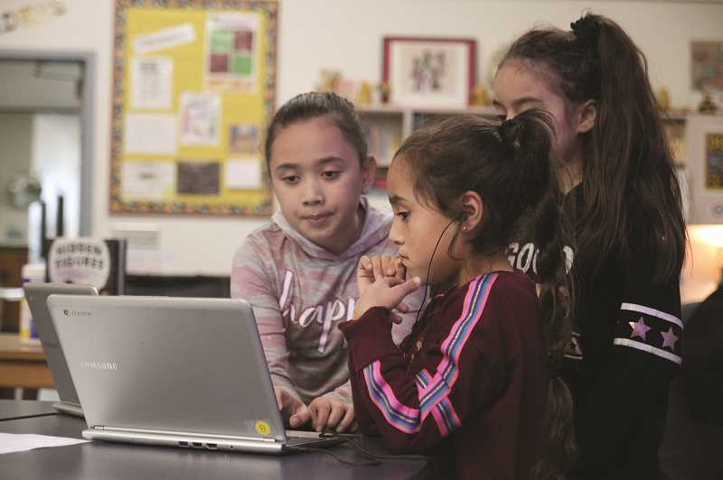 PMG PHOTO: PHIL HAWKINS - Sophia Gayton Quezada, Dulce Rivas Rodriguez and Alana Mercado Aguirre are among more than 60 girls, nearly 90 percent of Gervais Elementary's fourth and fifth grade girls, who have signed up for the school's lunchtime coding program this year.