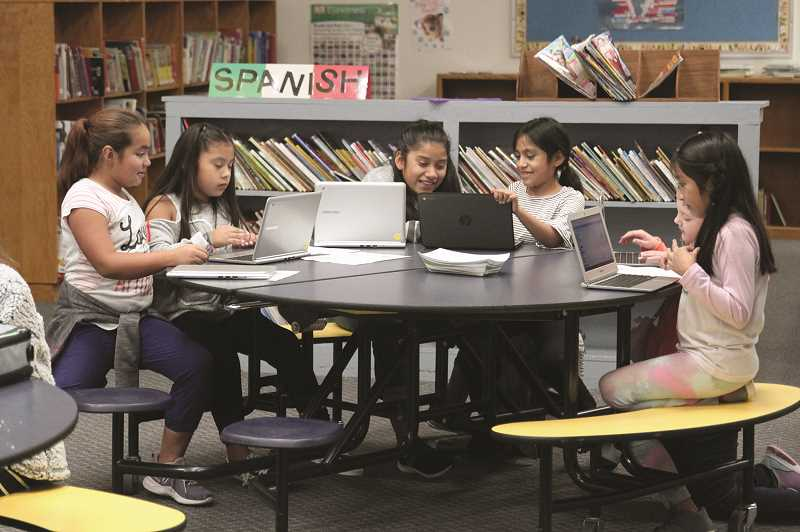 PMG PHOTO: PHIL HAWKINS - Fourth graders Anjeli Zepeda, Alexa Soza Ventura, Aracely Sanchez Cabrera, Karina Vega Flores, Rachel Broadhurst and Estrella Lagos Tienda are among students taking advantage of the Girls Who Code sessions, which GES has added in line with further STEM education (science, technology, engineering and math).