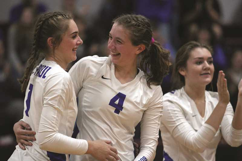 PMG PHOTO: PHIL HAWKINS - St. Paul senior Erin Counts (middle) embraces freshman Annabelle Davidson after the Buckaroos clinch a 3-0 victory over the Perrydale Pirates on Saturday to claim the Casco League tournament championship.