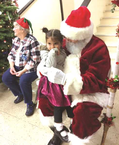 CAROL ROSEN - Last year, Santa paid a visit to the food and toy drive.