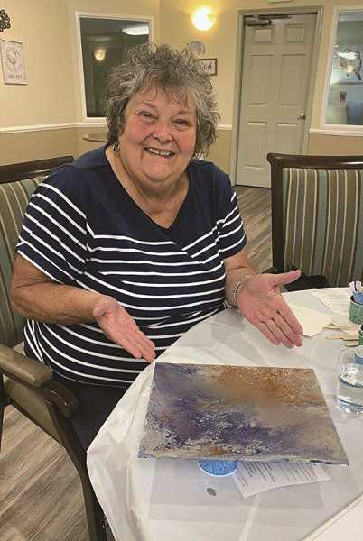 COURTESY PHOTO: EMERALD GARDENS - Sharon from Woodburn Estates & Golf was one of many community members outside Emerald Gardens to take part in Paint Night on Sept. 12.