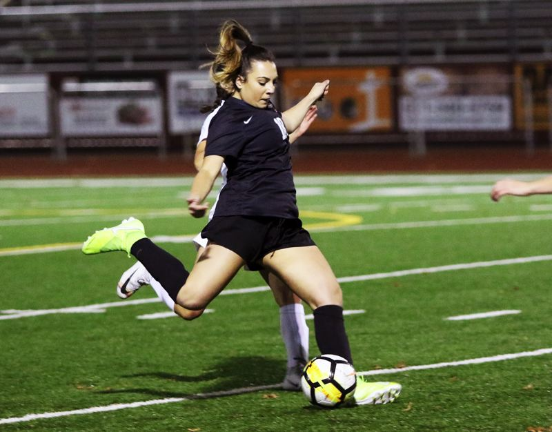 PMG PHOTO: DAN BROOD - Sherwood High School senior Isa Frost gets ready to boot the ball during the Lady Bowmen's 6-2 victory against McMinnville on Monday.