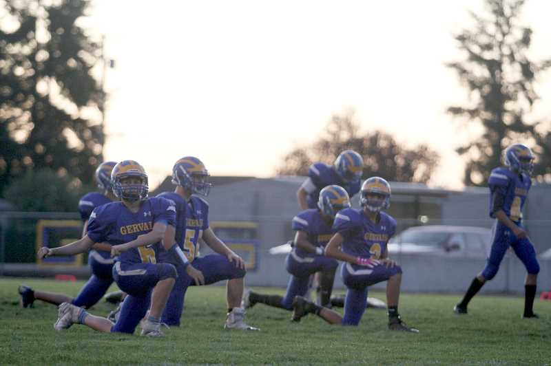 PMG PHOTO: PHIL HAWKINS - The Gervais football team warms up prior to their Friday night contest against Colton. The Cougars nearly didnt have a homecoming game this year after the Chemawa Braves dropped to a JV schedule, but the Vikings stepped up to replay Gervais in a non-conference game.