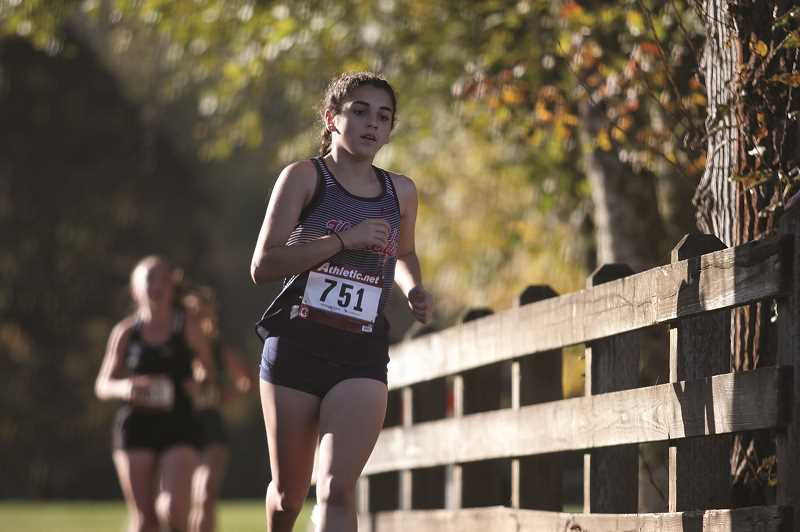 PMG PHOTO: PHIL HAWKINS - Kennedy's Cassie Traeger finished just a hair under 22 minutes, posting the second-best finish of her cross country career.