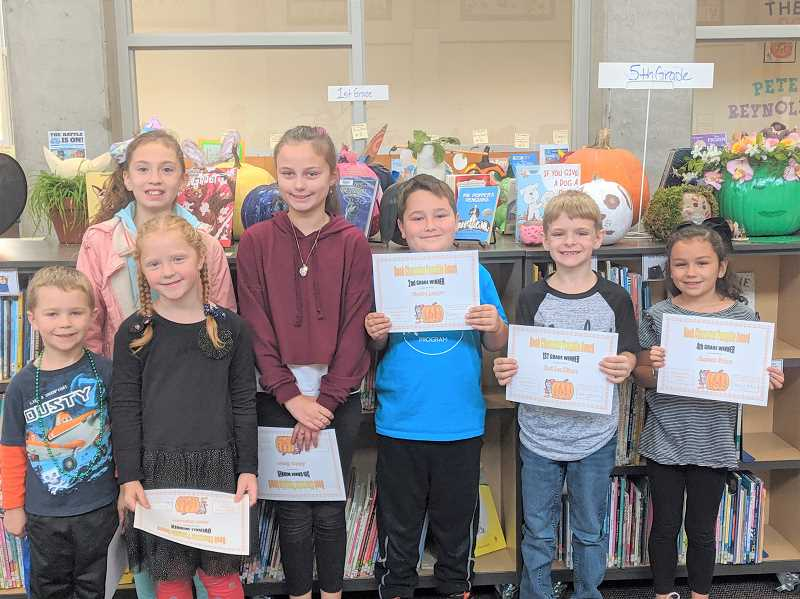 PMG PHOTO: EMILY LINDSTRAND - Six Clackamas River Elementary students were honored in the schools annual pumpkin decorating contest.