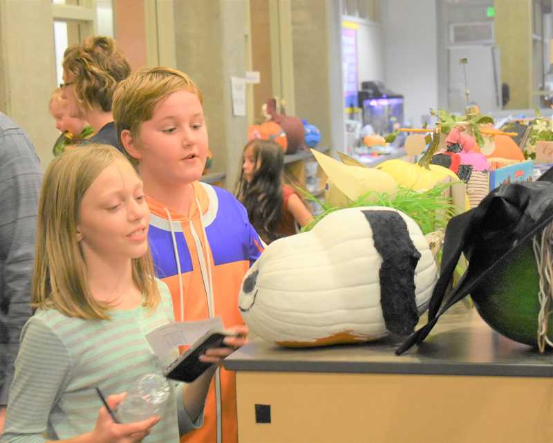 PMG PHOTO: EMILY LINDSTRAND - Clackamas River Elementary School students admire a Snoopy-inspired pumpkin during the school's Fall Family Night.