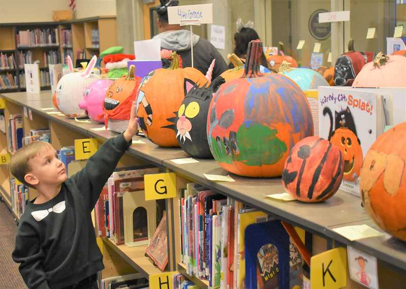 PMG PHOTO: EMILY LINDSTRAND - A variety of pumpkins were on display during Clackamas River Elementary School's Fall Family Night last week.