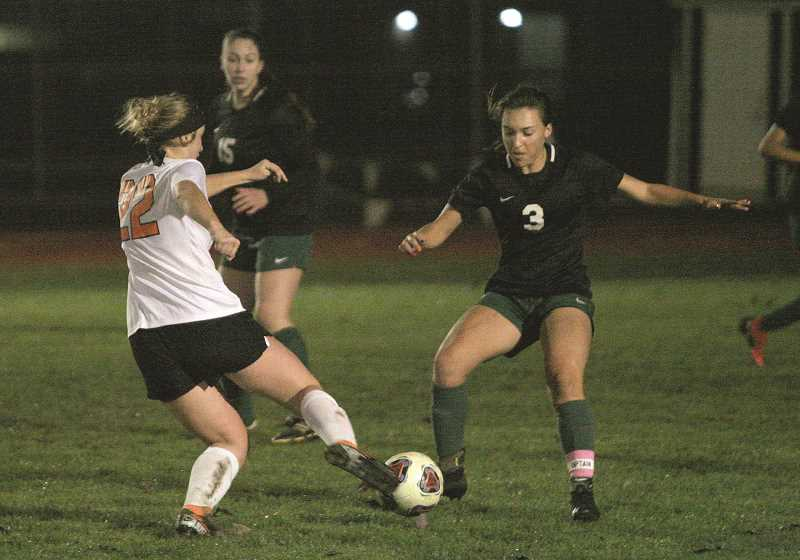 PMG PHOTO: JIM BESEDA - North Marion junior Mya Hammack meets Gladstone senior  Emma Reese for control of the ball  in the Huskies 1-0 loss to the top-ranked Gladiators last week.