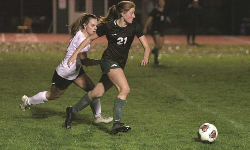 PMG PHOTO: JIM BESEDA - Despite currently being in third place in the Tri-Valley standings, Dani Christenson and the Huskies remain one of the top 4A teams in the state, currently at No. 5 in the OSAA rankings.