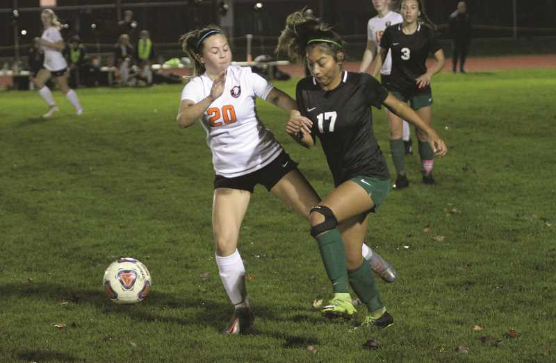 PMG PHOTO: JIM BESEDA - North Marion sophomore Dominique Huapeo nearly tied the game in the closing minutes, but her 18-yard shot in the 77th minute hit the top cross bar.