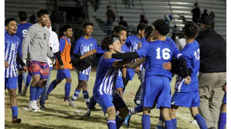 STEELE HAUGEN - The Madras boys soccer team celebrates after beating Molalla 3-2 Oct. 23.