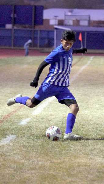 STEELE HAUGEN - Manny Flores launches the ball down the field to an open White Buffalo.