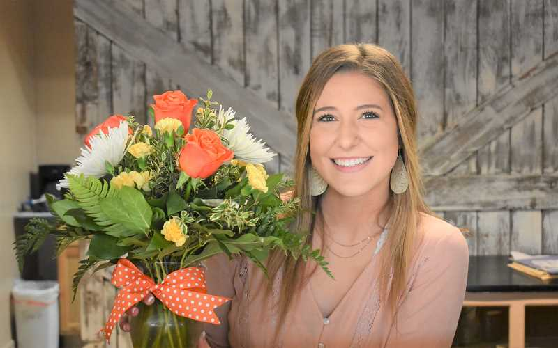 PMG PHOTO: EMILY LINDSTRAND - Emalee Long, a 2019 alumna of Estacada High School, is the owner of  Blush & Roses Flower Shop, which will soon open on Broadway Street.