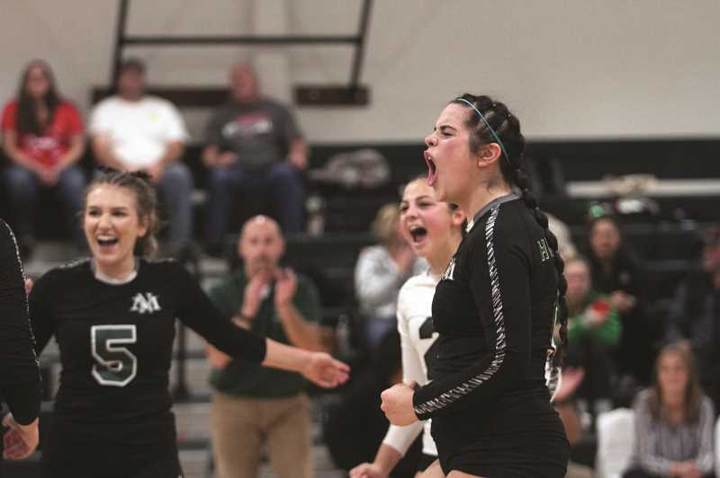 PMG PHOTO: PHIL HAWKINS - Senior Kelsey Richardson celebrates a point for the Huskies in the teams 3-2 loss to Corbett. Richardson is one of four seniors on the team who celebrated senior night, along with Katie Ensign, Alana Walls and Abby Marin.