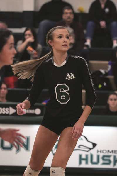 PMG PHOTO: PHIL HAWKINS - Senior Katie Ensign provided an all around game for the Huskies on Wednesday night, serving as a primary defender at the net while laying down a number of points against the Cardinals.
