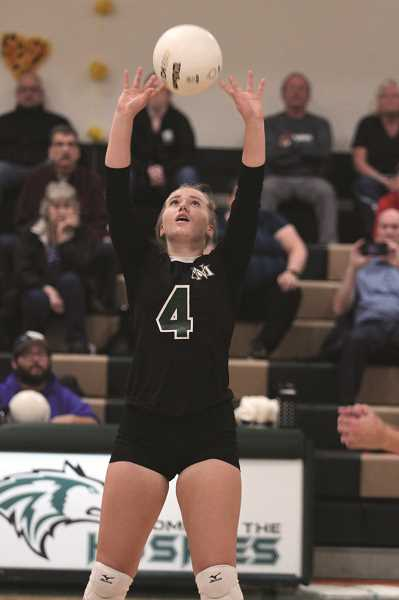 PMG PHOTO: PHIL HAWKINS - Sophomore Mackenzie Agnew sets up a teammate in the opening set.