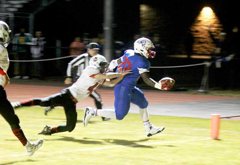STEELE HAUGEN - Treyvon Easterling reaches to the pylon during Madras' 22-0 victory over Corbett Oct. 25.