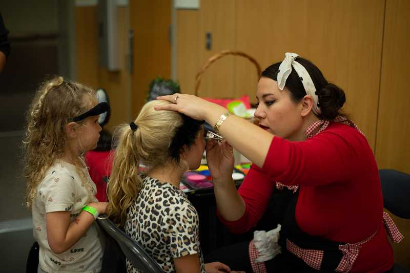 PMG PHOTO: ANNA DEL SAVIO - Students received colorful face paint.