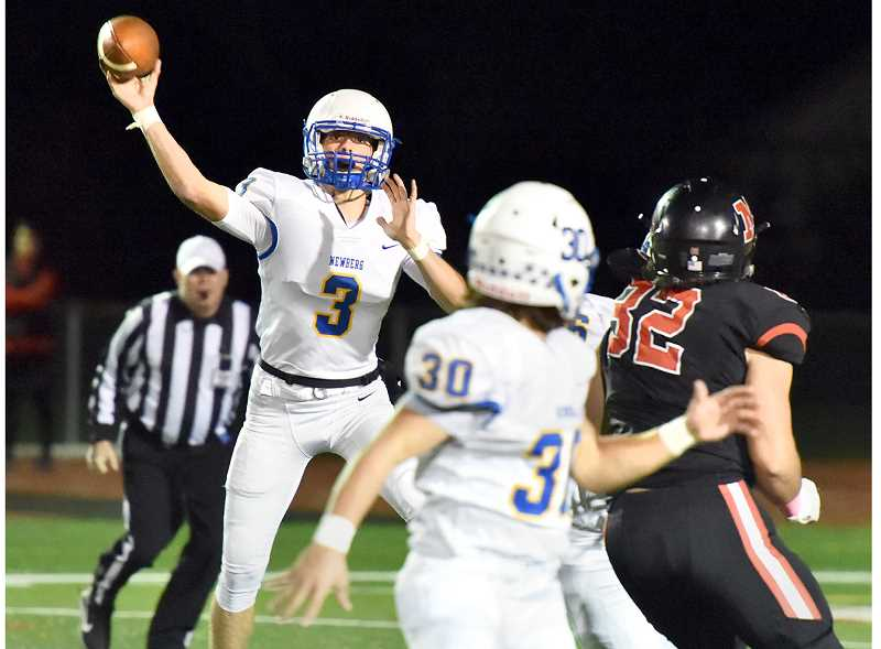 PHOTO BY DEAN TAKAHASHI - Sophomore quarterback Levi Durrell threw for a touchdown in Newberg's win over McMinnville on Friday.