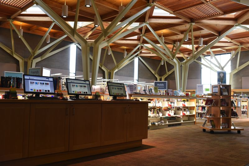 COURTESY PHOTO: JENNY SWANSON - Distinctive architecture in the Sherwood Public Library, including noise-dampening wood panels on the ceiling, helps to make the library an inviting and calming place to spend time.