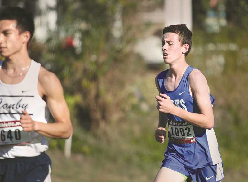 INDEPENDENT PHOTO: PHIL HAWKINS - St. Paul junior Broden Lear placed 16th at the Creekside Classic, finishing the race in 16:57 to set a new personal record.