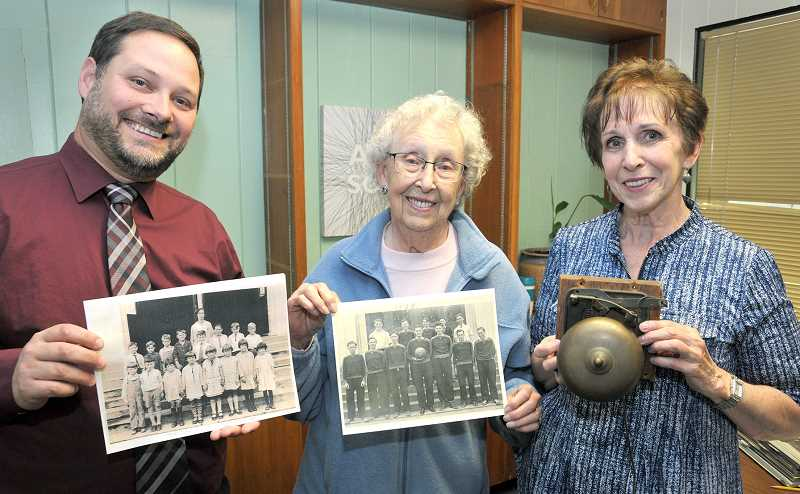 GRAPHIC PHOTO: GARY ALLEN - Sandra Sumner (right) returned a 119-year-old bell to Dundee Elementary School earlier this month. She is joined by Janis Sander (center) and principal Reed Langdon.