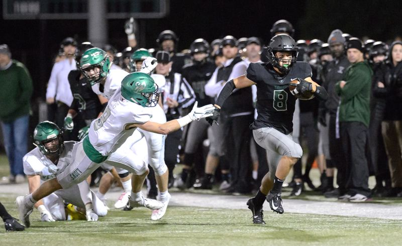 COURTESY PHOTO: CHRISTOPHER GERMANO - Tigard High School senior Josh Burns (8) sprints down the sideline on his way to scoring one of his four touchdowns for the Tigers in their 42-21 victory over West Linn.