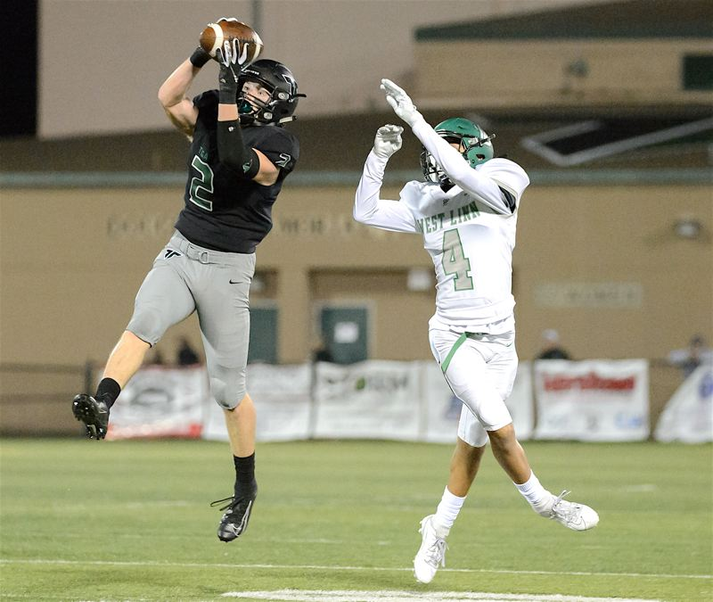 COURTESY PHOTO: CHRISTOPHER GERMANO - Tigard High School senior defensive back Tyler Penn (2) goes up high to intercept a pass intended for West Linn freshman Jackson Shelstad during Friday's game.