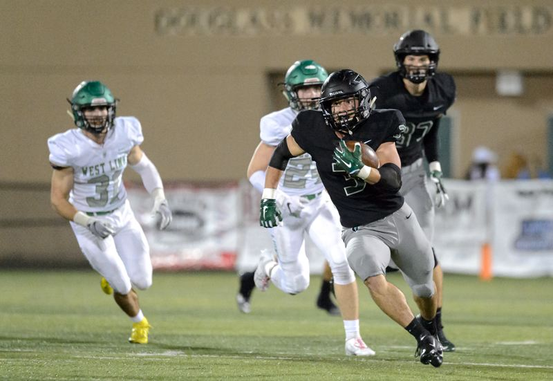 COURTESY PHOTO: CHRISTOPHER GERMANO - Tigard High School senior running back Hunter Gilbert breaks into the clear during the Tigers' 42-21 league win over West Linn on Friday.