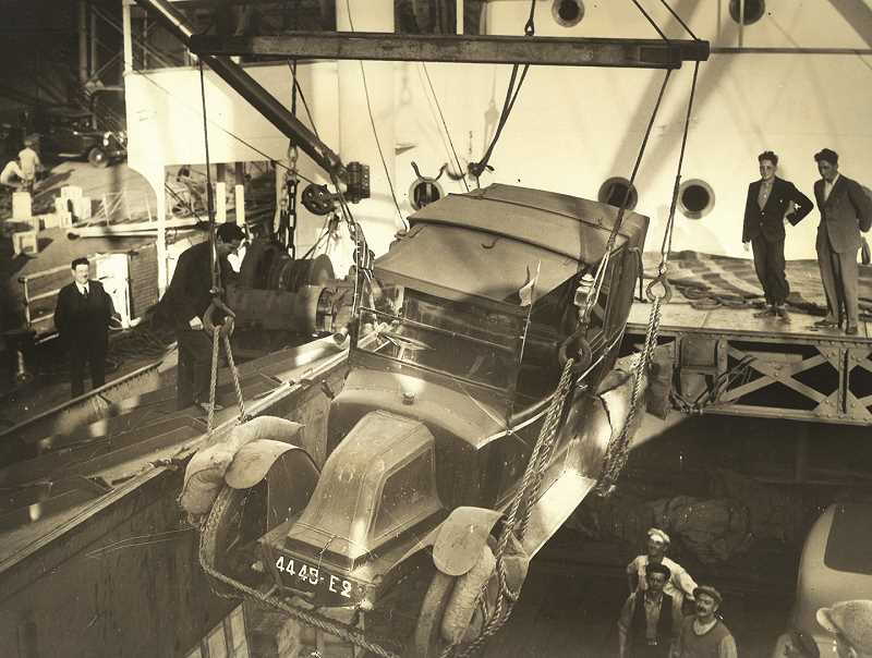 COURTESY PHOTO: DON DOWNING - The 'Marne Taxi' being unloaded from its transport boat in 1935. The 1910 Renault was used during World War I to transport troops to the Marne River to stop the German advance. Downing said that this one is the only existing 'Marne Taxi' left.