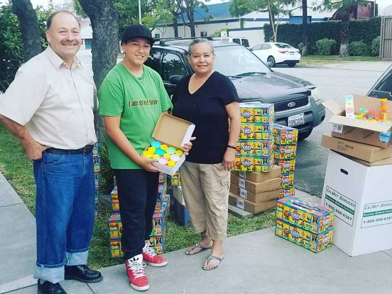 COURTESY PHOTO: RUSSELL BOSCHETTO - Symond picks up a donation of Play-doh for the driving benefitting hospitalized children.