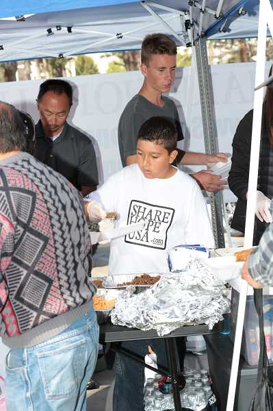 COURTESY PHOTO: RUSSELL BOSCHETTO - Symond serves food to the homeless.