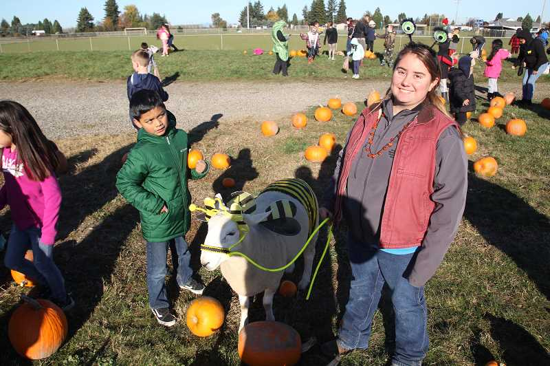 PMG PHOTO: JUSTIN MUCH - Dresen Freschweilers bumble-bee sheep, Katrina, was a hit during the Gervais FFA Elementary School Community Pumpkin Patch on Thursday, Oct. 30.