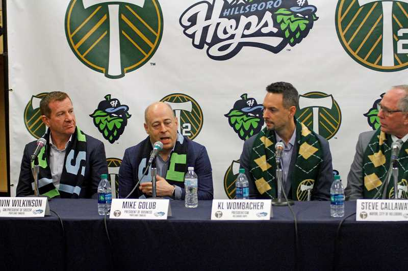 PMG PHOTO - Timbers GM/President of Soccer Gavin Wilkinson, Timbers President of Business Mike Golub, Hillsboro Hops President K.L. Wombacher, and Hillsboro Mayor Steve Callaway at the press conference to announce the teams' new partnership Wednesday morning, Oct. 30, at Hops Field in Hillsboro.