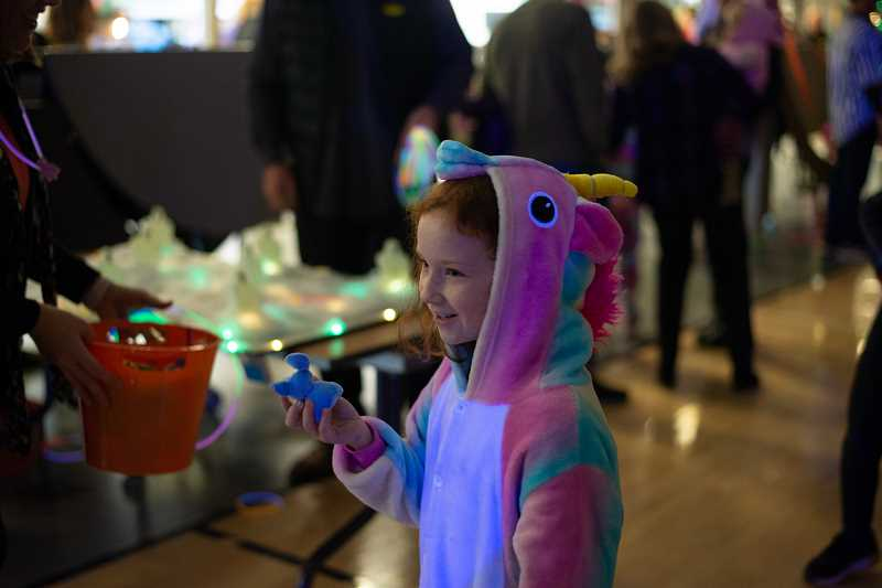 PMG PHOTO: ANNA DEL SAVIO - Students earned prizes from games like a ring toss.