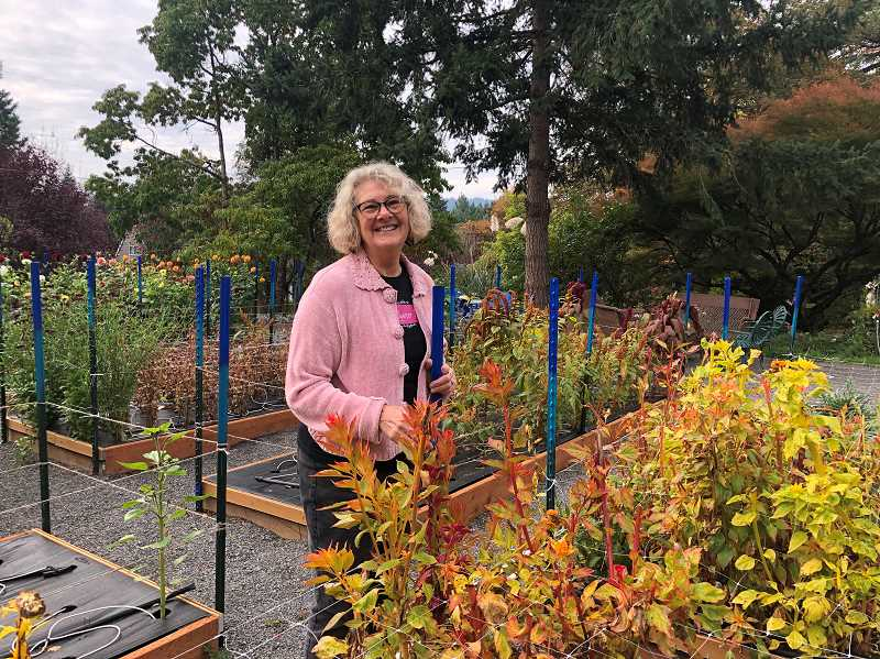 PMG PHOTOS: BARB RANDALL - Artist Ann Munson poses in her garden at 4th Quarter Farm in West Linn. After her husband died she needed a challenge, and wanted to improve life for those living in senior assisted living facilities. The garden provides both.