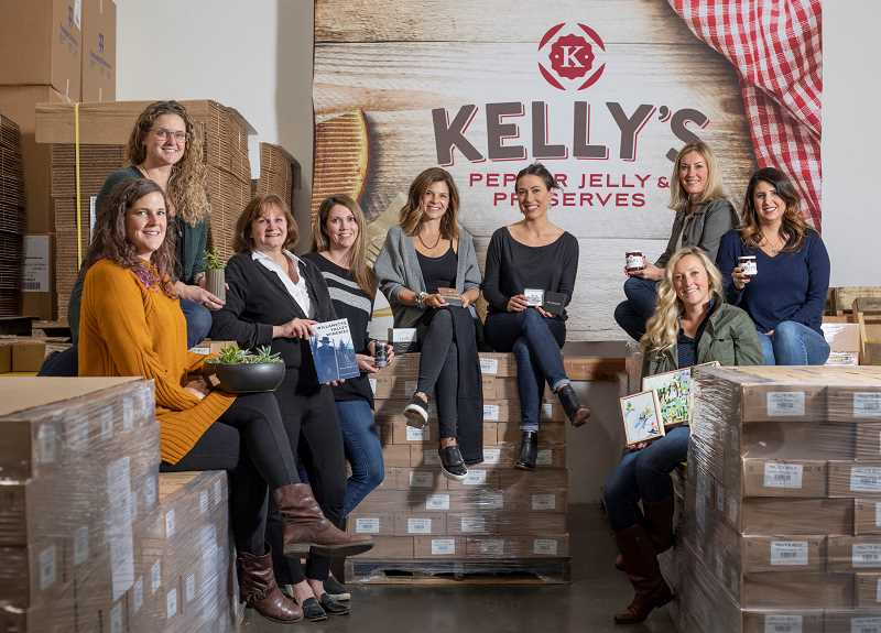 PGM PHOTO: JONATHAN HOUSE - Kelly Calabria, owner and founder of Kellys Jelly, is hosting a holiday open house market Nov. 7 at the Kellys Jelly warehouse. Vendors include from left Carie Nedley and Sara Childers of Potted in Portland, author Barb Randall, Kaitlin Johnson of Lucietta Wines, Hannah Westwood of Wear Westwood, Shannon Crain of Sela and Sage, Kelly Calabria and Hilary Smith of Kellys Jelly, and Stefani Togni of Stefani Togni Art. The holiday mart is free and open to all.