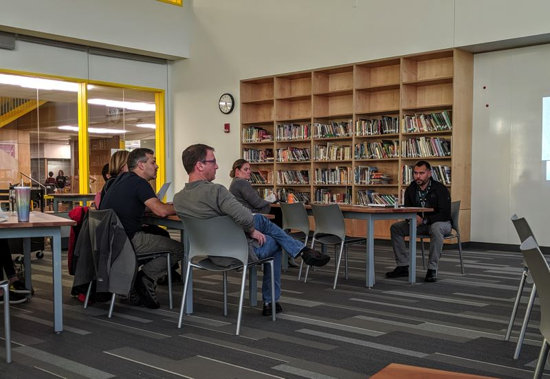 PMG PHOTO: COURTNEY VAUGHN - Parents get an update from Beaverton School District facilities chief Josh Gamez on Thursday, Oct. 24, after a roof leak and mold issues caused West Tualatin View Elementary students to be shuffled to another school for a month.
