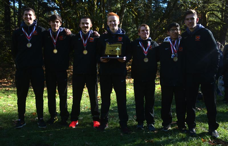 PMG PHOTO: DEREK WILEY - Molalla's boys cross country team won the Tri-Valley Conference district championship Wednesday at McIver Park