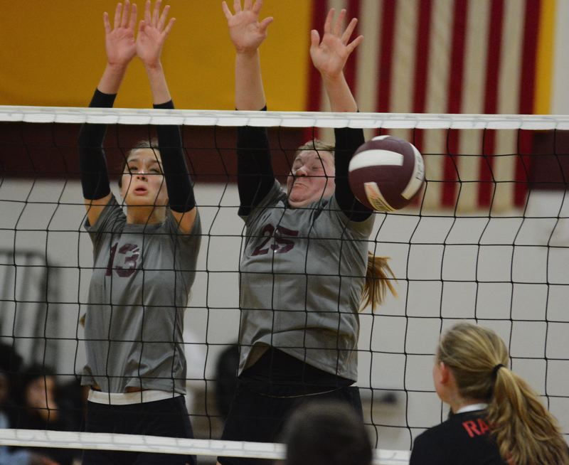 PMG PHOTO: DAVID BALL - Damascus Christians Nina Piscitello (13) and Katie Bailey put up a block in the first set of Wednesdays playoff sweep of Dufur.