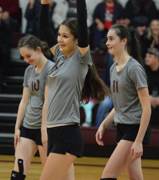 PMG PHOTO: DAVID BALL - Damascus Christians Nina Piscitello (middle) raises her hands to celebrate an Eagles point in the first set.