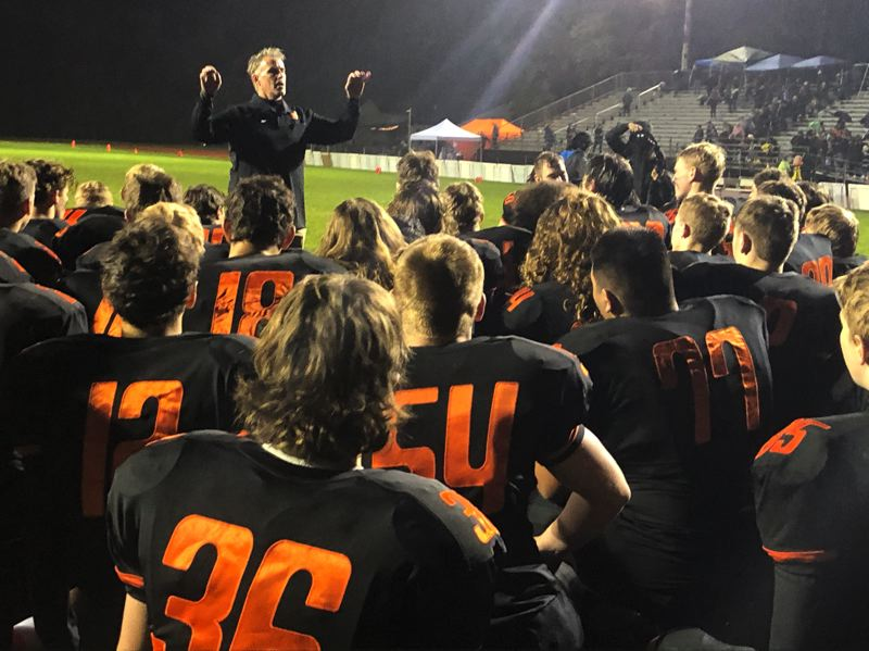 PMG PHOTO: STEVE BRANDON - Scappoose players gather as coach Sean McNabb talks after a victory at home.