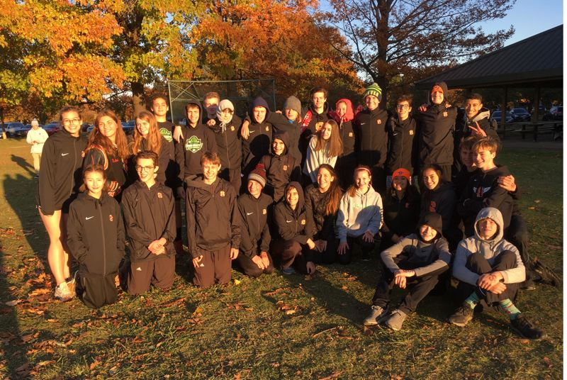 COURTESY PHOTO: KEVIN PINKSTAFF - The Scappoose High boys and girls cross country teams gather after Wednesday's Northwest Oregon Conference district meet at Blue Lake Park.