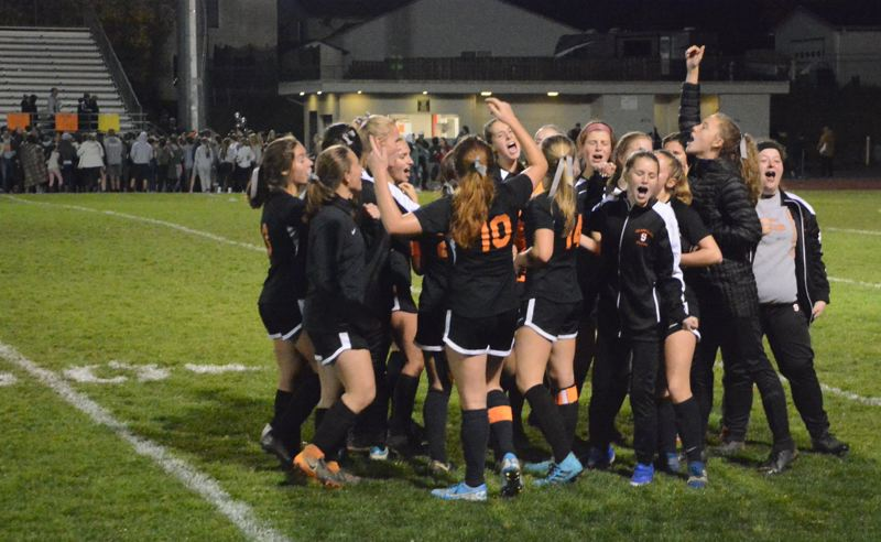 PMG PHOTO: STEVE BRANDON - The Scappoose Indians celebrate after their 2-1 victory on the high school field over Putnam.