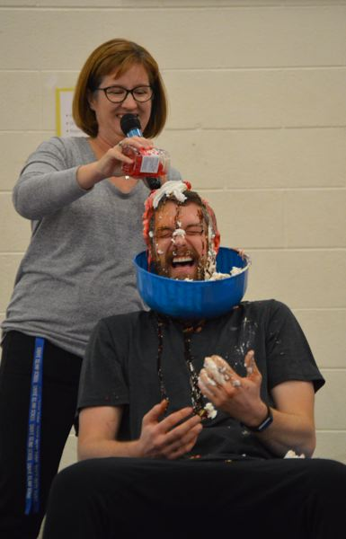PMG PHOTOS: NICOLE THILL-PACHECO - Students at Sauvie Island School raised $16,273 during their annual jog-a-thon school fundraiser and as a prize for reaching their goal, the class that raised the most money got to help turn their teacher, Mr. Shea, into an ice cream sundae.