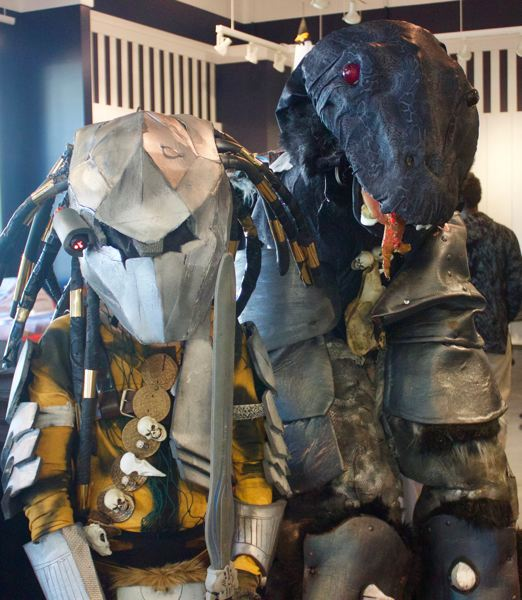 PMG PHOTO: CHRISTOPHER KEIZUR - Kaden Spencer and his mother Dawn Rasmussen dressed up as the Predator and an alien for the Gresham Station Costume Contest.